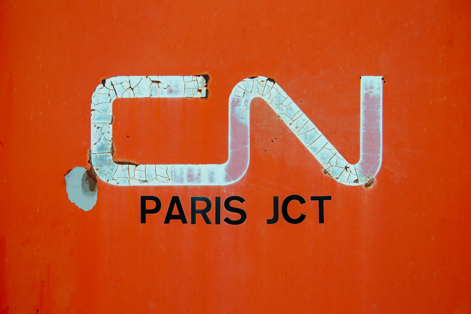 The CN logo stamped on a junction box at Paris Junction.